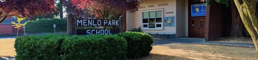 an image of a sign with the words Menlo Park School with the school building in the background.